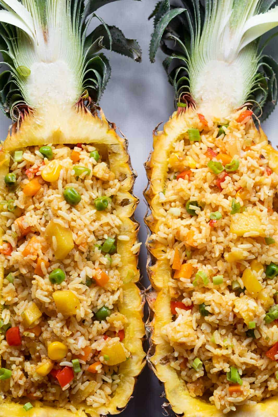 Thai Pineapple fried rice served in pineapple boats