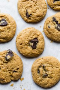 Eggless chocolate chips cookies freshly baked on a cookie sheet
