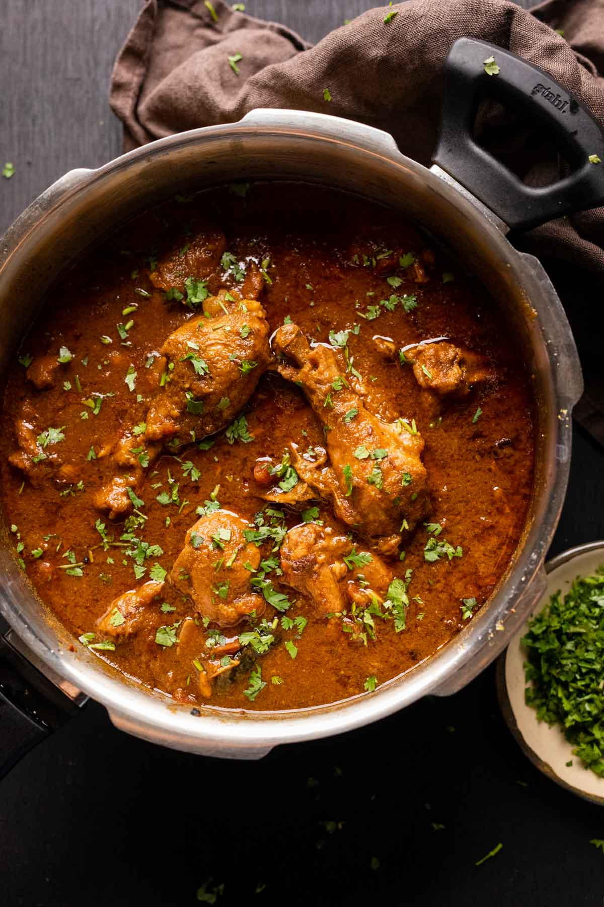 Dhaba style chicken curry served in the pressure cooker it was made in