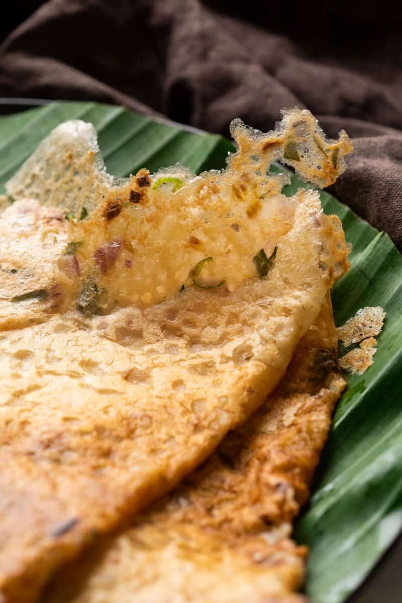 Closeup of oats dosas to show the crispy texture